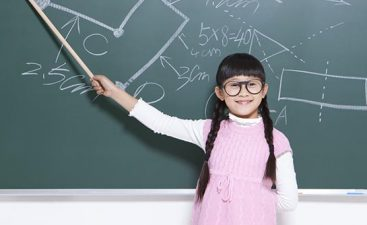 Humorous little girl playing teacher in classroom